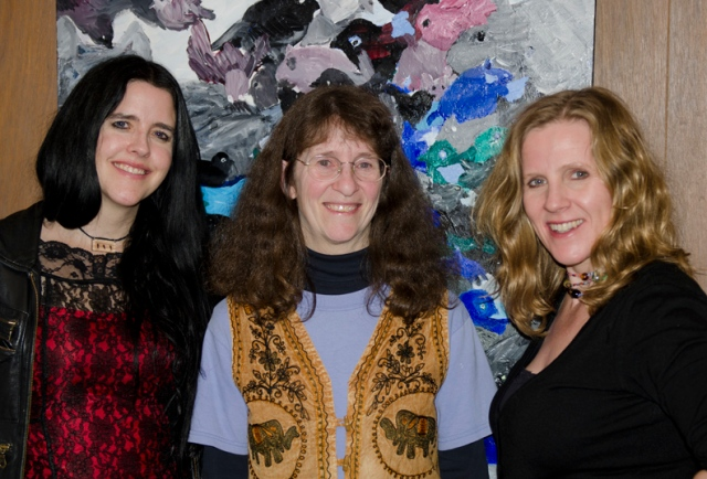 Catherine Owen, Kim Goldberg, Karen Moe in front of one of Joe Rosenblatt's paintings.