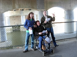 Covert Poverts perform REACTORS in the Pearson Bridge underpass to mark the 3rd anniversary of the Fukushima nuclear disaster. Kim GOldberg, Kim Clark, Darryl Knowles. (Photo by Katy McCuish)