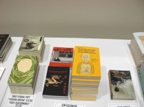A couple of my titles, Red Zone & Ride Backwards on Dragon, for sale on the Seattle U bookstore table, alongside Kamesan's World Anthology of Haiku on War, Violence, and Human Rights Violations, which I am honored to be included in. (Photo © Kim Goldberg)