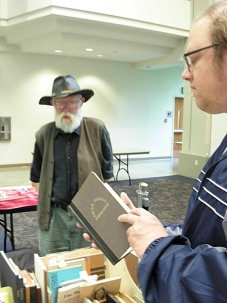 Warren Dean Fulton examines a hardcover edition of Robinson Jeffers' Dear Judas at the Small Press Fair. (Photo © Kim Goldberg)