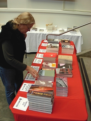 Heidi Greco explores the Seattle U book table at the Small Press Fair. Seattle U Campus Store did a phenomenal job of ordering books of all the Festival poets to have them available for sale during the fest. Thank you William Cannon! (Photo © Kim Goldberg)