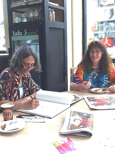 BC poets Joanne Arnott & Kim Goldberg chillin in Seattle's High Five Pies (Photo © Yvonne Blomer)