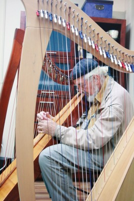 David Weston spends a quiet moment playing the harp during the Nanaimo Conservatory of Music's open house in 2012. — Image Credit: Rachel Stern Photo, Nanaimo News Bulletin