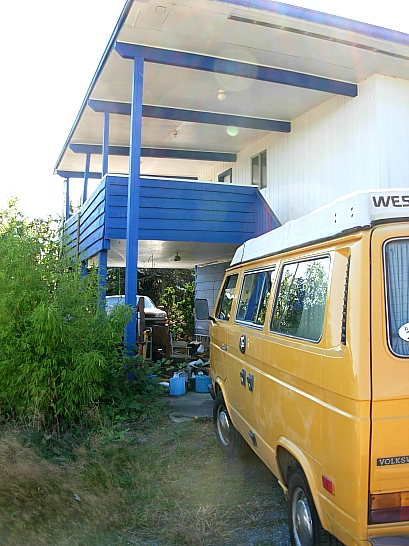 The drive-thru carport on concrete slab can accommodate 2 tall vehicles
