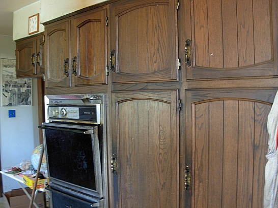 "Kitchen cabinets are copious in this house but very ""1970s"" - probably time for a re-do"